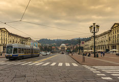 Tram passing Veneto square in Turin on cloudy day. Tram passing the Veneto square in Turin, Italy with people in the background Stock Photos