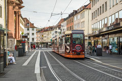 Tram and people in the city center of Wurzburg, Bavaria, Germany Royalty Free Stock Images