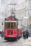 Tram and people in daily life under snow rain at Istiklal Street. Istanbul, Turkey - January 10, 2017: Tram and people in daily life under snow rain at Istiklal Stock Photo