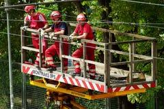 Tram power grid maintenance works in Warsaw, Poland. Tram power grid maintenance works on 31 August 2014 in Warsaw, Poland. Workers in crane basket repair Stock Photography