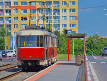 Tram in Prague, Czech Republic. Red tram in the city on a sunny day Stock Images