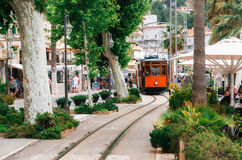 Tram on the promenade of Port de Soller. Royalty Free Stock Images