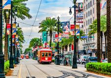 Tram pubic transport on Canal Street in New Orleans, Louisiana. New Orleans, Louisiana - February 6, 2017: Tram pubic transport on Canal street stock photography