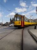 Colourful tram running on a tramway stock photo