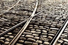 Tram rails on the cobblestones of the street Royalty Free Stock Image