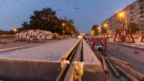 Tram rails at the stage of their installation and integration into concrete plates on the road timelapse hyperlapse. stock video footage