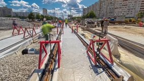 Tram rails at the stage of their installation and integration into concrete plates on the road timelapse hyperlapse.