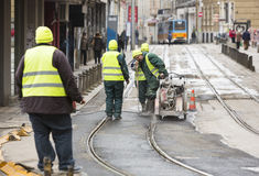 Tram rails workers stock photo