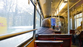 Tram ride in Munich. MUNICH, GERMANY - FEBRUARY 23, 2016: Riding a famous 28 old style tram in the city center. Few unidentified people inside, changing stock footage