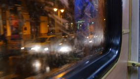 Tram Ride Night. Tram Ride by night in Budapest with view on the streets of Budapest through the window, 4K stock footage