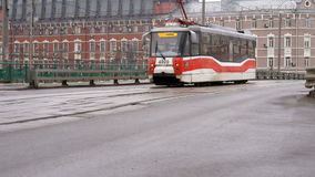 The tram rides along the street. Afternoon in cloudy weather stock footage