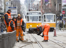 Tram road workers repair repairing hummer Royalty Free Stock Image