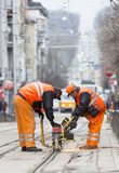 Tram road workers repair repairing Royalty Free Stock Photos