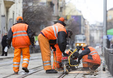 Tram road workers repair repairing Royalty Free Stock Photo