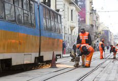 Tram road workers repair repairing Stock Photo