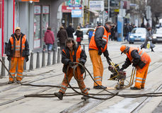 Tram road workers repair repairing Royalty Free Stock Image