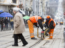 Tram road workers repair repairing Stock Photos