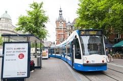 Tram running in the city centre in Amsterdam Royalty Free Stock Photos