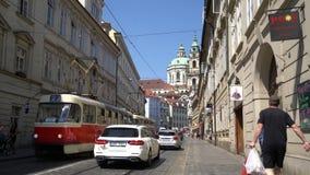 A tram runs in Prague. A tram runs through a street of the historic center in Prague, Czech Republic stock footage