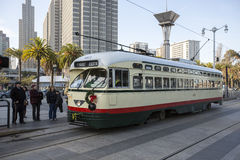 Tram in San Francisco. SAN FRANCISCO, DECEMBER 31: Passengers ride in a tram on December 31, 2013 in San Francisco. It is the most popular way to get around the Royalty Free Stock Photo