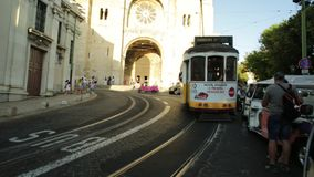 Tram 28 and Se Cathedral stock video footage