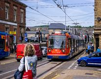 Tram in Sheffield. Tram arriving at passnger stop in Sheffield, Yorkshire, UK on 18 May 2018 stock image