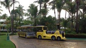 Tram shuttle bus in resort. Yellow tram shuttle bus in resort stock video