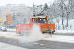 A tram snowplow clearing snow from tracks stock photo