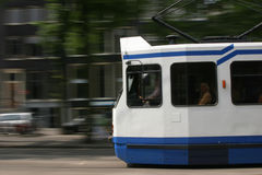 Tram speeding past. A tram is speeding past in one of the Amsterdam streets Stock Photo