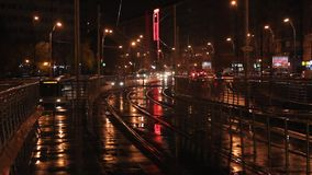 Tram station at night after rain. Tram station by night at passage Bucur Obor in Bucharest, Romania stock footage