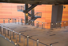 Tram Station Platform. An orange wall forms a backdrop for a modern staircase and platform at a tram station royalty free stock photography