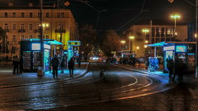 Tram station timelapse. Tram station by night in Zagreb. People crossing the street stock footage
