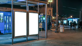 Tram station timelapse. Tram station by night in Zagreb. Two big city light displays where you can place your poster design for presentation purpose stock video