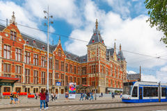 The tram stop near Amsterdam Centraal station. Amsterdam, Netherlands - July 29, 2014: The tram stop near Centraal station. Amsterdam Centraal station is the Royalty Free Stock Photos
