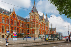 The tram stop near Amsterdam Centraal station. Amsterdam, Netherlands - July 29, 2014: The tram stop near Centraal station. Amsterdam Centraal station is the Stock Photos