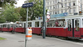 A tram stop on the Ring in Vienna. A typical red tram in the ring road in Vienna stock video footage