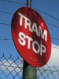 Tram Stop sign. Tram stop warning sign with fence and sky backgraound Royalty Free Stock Image