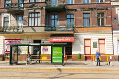 Tram stop and small stores Stock Photos