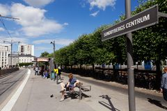 Tram stop Sundbyberg. Sundbyberg, Sweden - August 2, 2017: People waiting at he tram stop Sundbyberg Centrum at the Tvarbanan service Royalty Free Stock Images