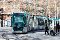 Tram on street in Barcelona Stock Image