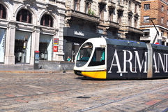 Tram in the street of Milan. MILAN, ITALY - JUNE 20: Speed tram goes down the street in Milan downtown on June 20, 2015. Milan is the capital of Lombardy and one Stock Image
