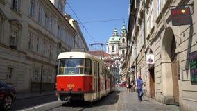 A tram in the street in Prague. A tram runs through a street of the historic center in Prague, Czech Republic stock video