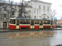 Tram on the street in the rainy day. stock photo