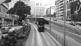 Tram through the streets of Hong Kong. HONG KONG - SEP 27: Tram through the streets of Hong Kong on SEP 27, 2013 in Central, Hong Kong, China. Central is the stock video footage