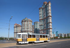 The tram on Stroginskoye highway in sunny summer day, Moscow Stock Images