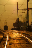 Tram in sunset. Traffic on crossroad in sunset Royalty Free Stock Photos