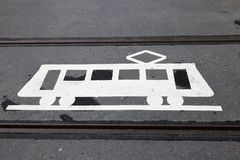 Tram symbol. A road marking tram warning sign painted on the tramway stock image