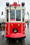 A tram in Taksim Square, Istanbul, Turkey. A red and white tram sits awaiting passengers on an overcast day in Taksim Squre, Istanbul, Turkey stock photos