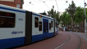 Tram to Central Station Amsterdam  City of Amsterdam stock video
