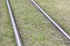 Tram tracks in the grass Stock Photo